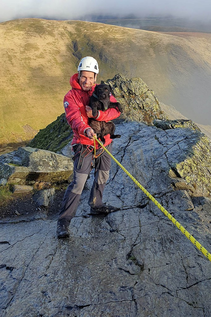 A team member with the rescued dog. Photo: Keswick MRT