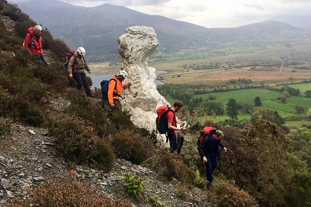 Rescuers make their way past The Bishop, the white-painted rock part-way up Barf. Photo: Keswick MRT