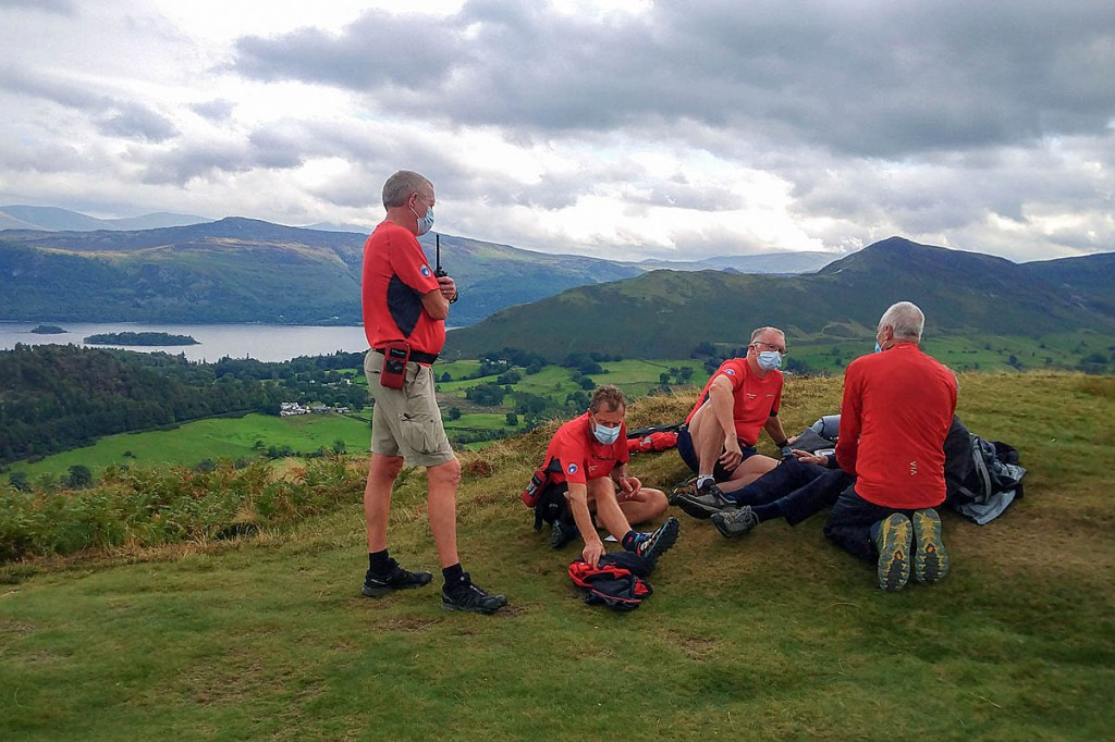 Rescuers with the casualty on Barrow. Photo: Keswick MRT