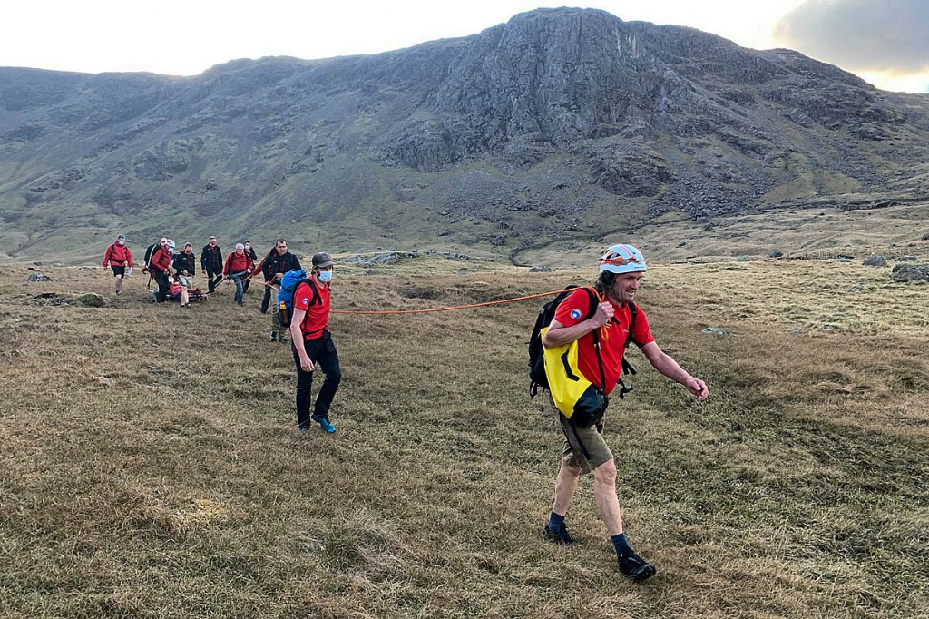 Rescuers stretcher the injured walker from the fells. Photo: Keswick MRT