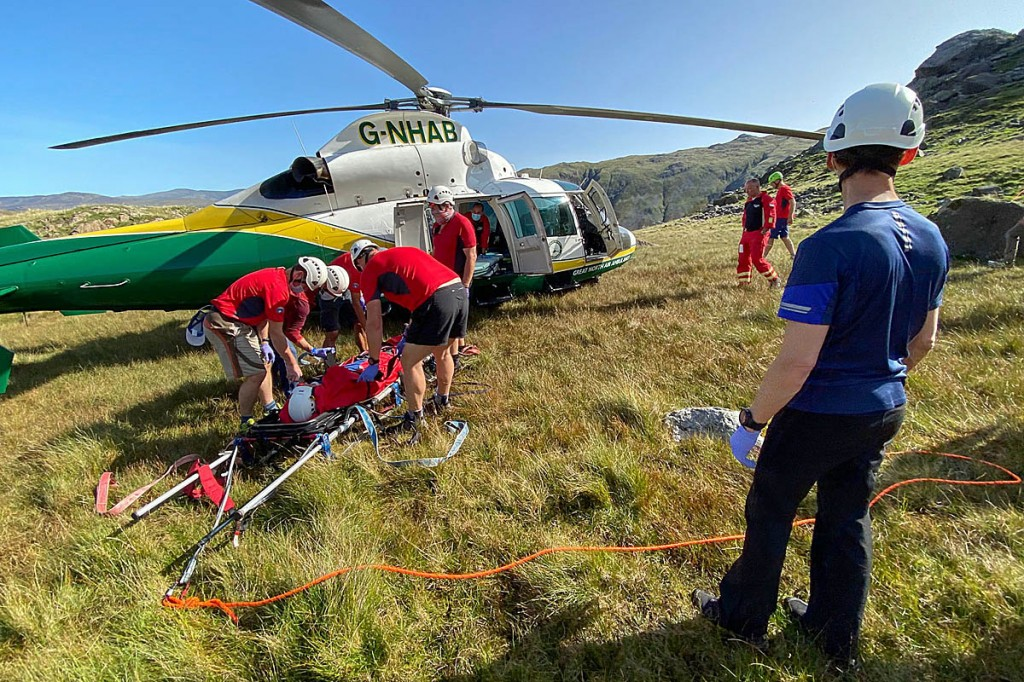 Rescuers with the air ambulance at the scene of the Base Brown incident. Photo: Keswick MRT