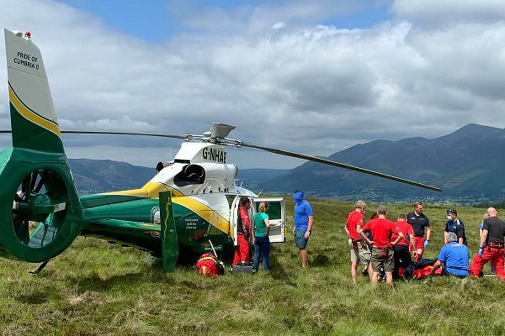Rescuers with the air ambulance on Bleaberry Fell. Photo: Keswick MRT