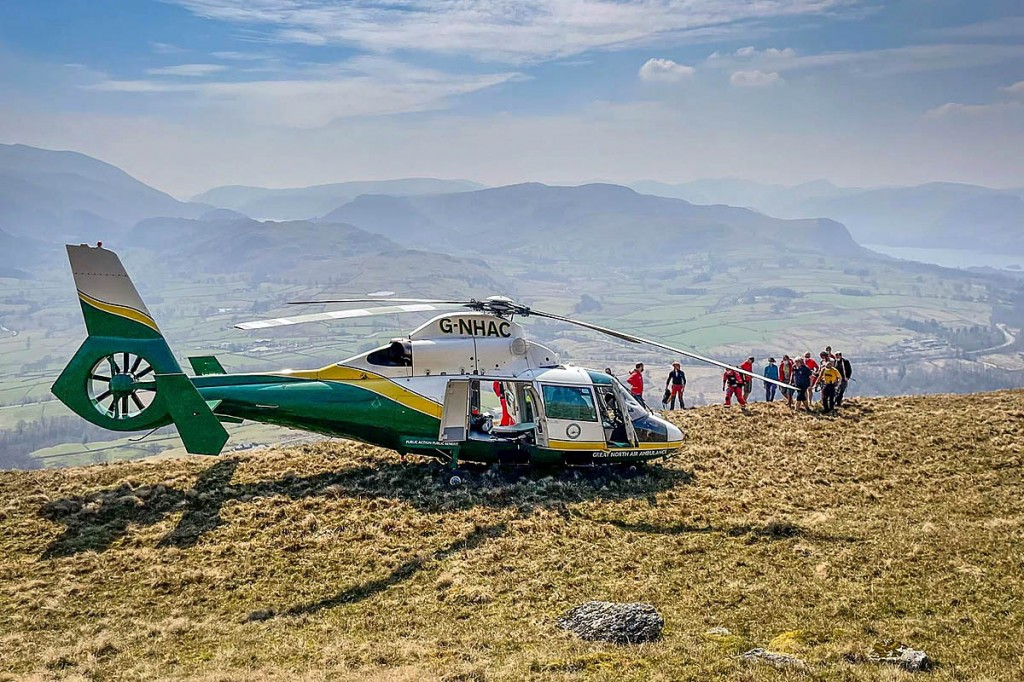 Rescuers approach the air ambulance on Blease Fell. Photo: Keswick MRT