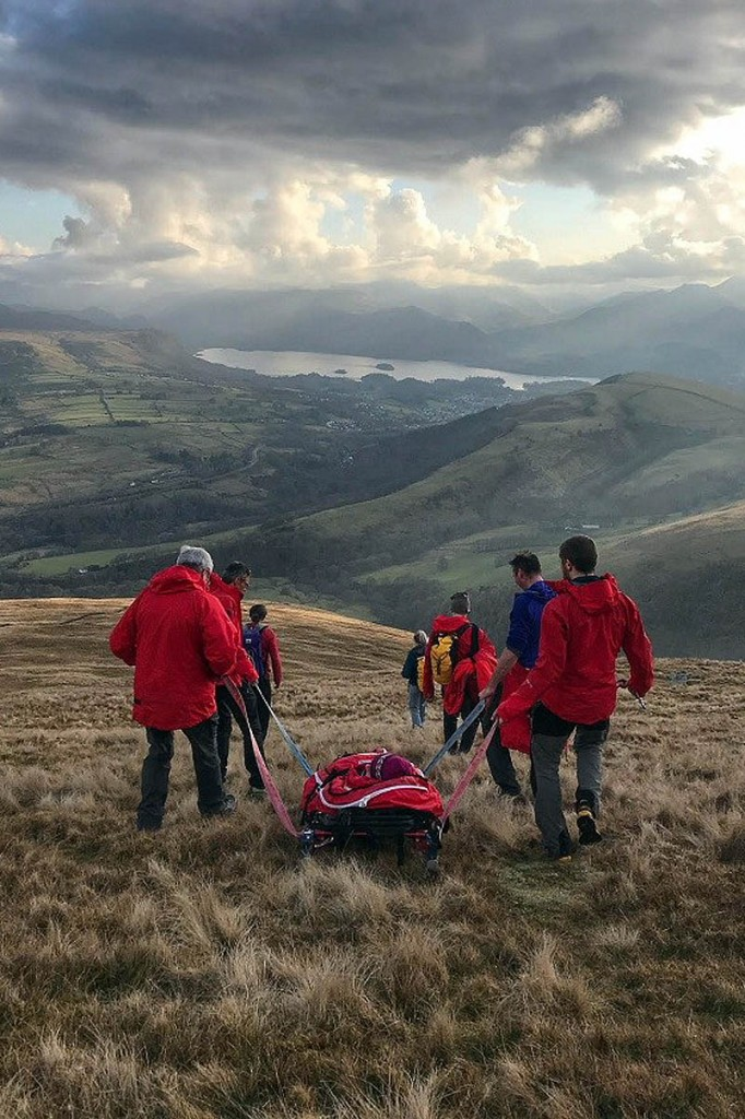 Team members stretcher the injured walker down Blencathra. Photo: Keswick MRT
