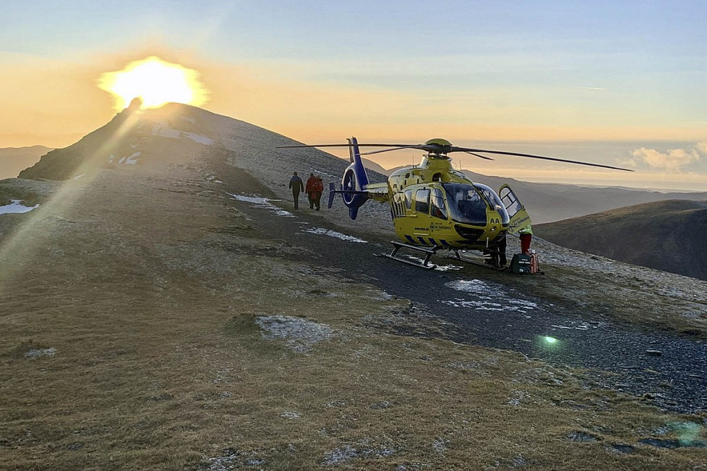 Rescuers and the air ambulance at the scene on Blencathra. Photo: Keswick MRT