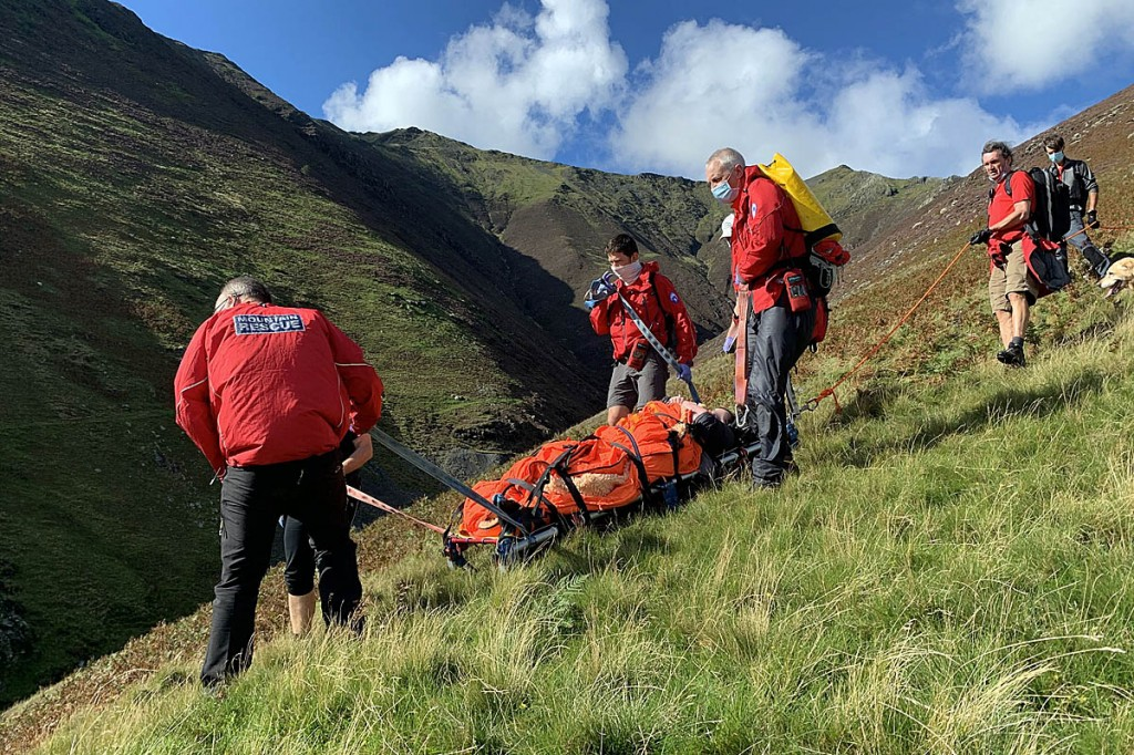 Rescuers stretcher the injured walker from Hall's Fell Ridge. Photo: Keswick MRT