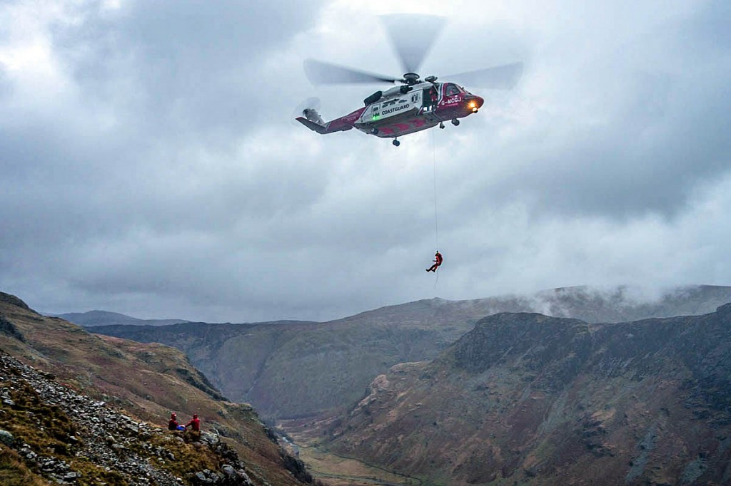 The Coastguard helicopter and rescuers at the scene. Photo: Keswick MRT