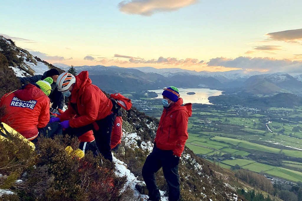 Team members tend to the injured walker on Carl Side. Photo: Keswick MRT