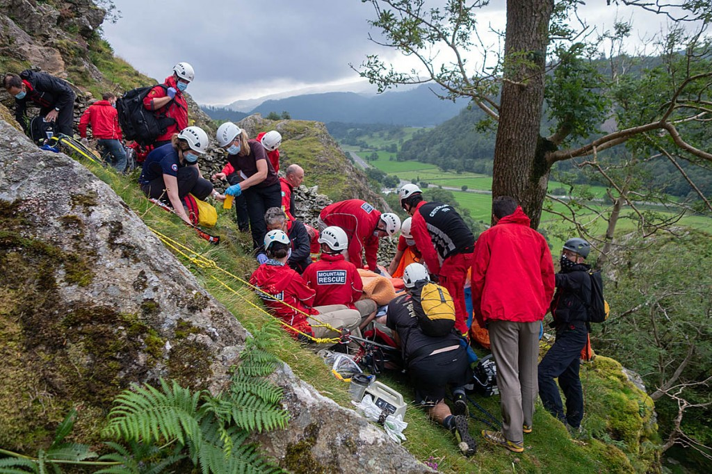 Rescuers tend to the injured climber. Photo: Keswick MRT