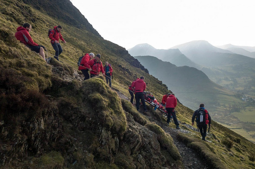 Team members stretcher the injured walker down the steep slopes of Cat Bells. Photo: Keswick MRT
