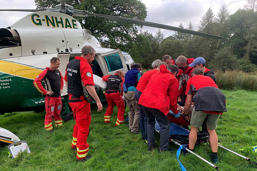 Rescuers prepare to load the walker into the air ambulance. Photo: Keswick MRT