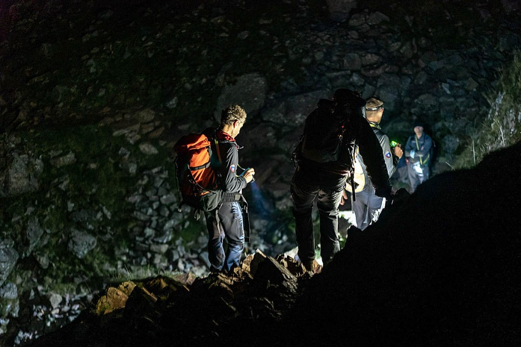Rescuers accompany the walkers to safety. Photo: Keswick Mountain Rescue Team