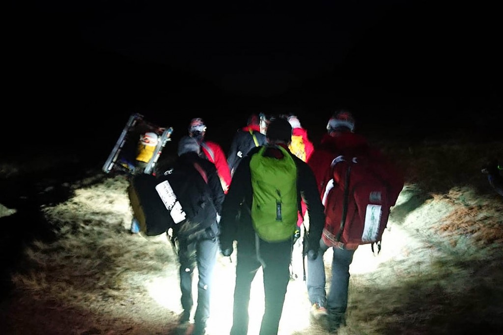 Rescuers stretchered the man from the fell. Photo: Keswick MRT