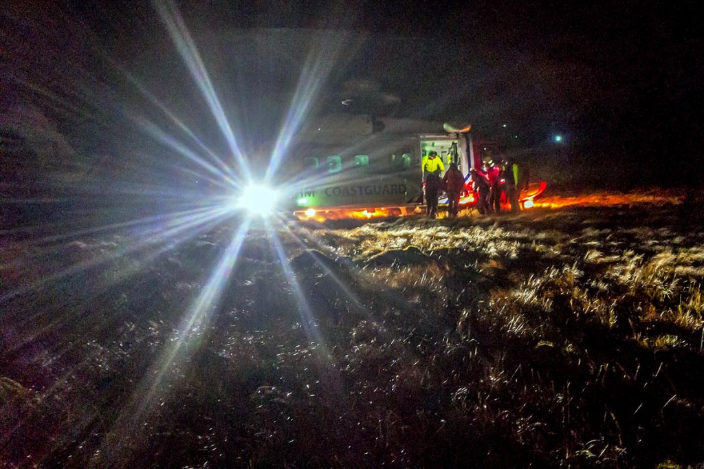 Rescuers help the boy to the Coastguard helicopter. Photo: Keswick MRT