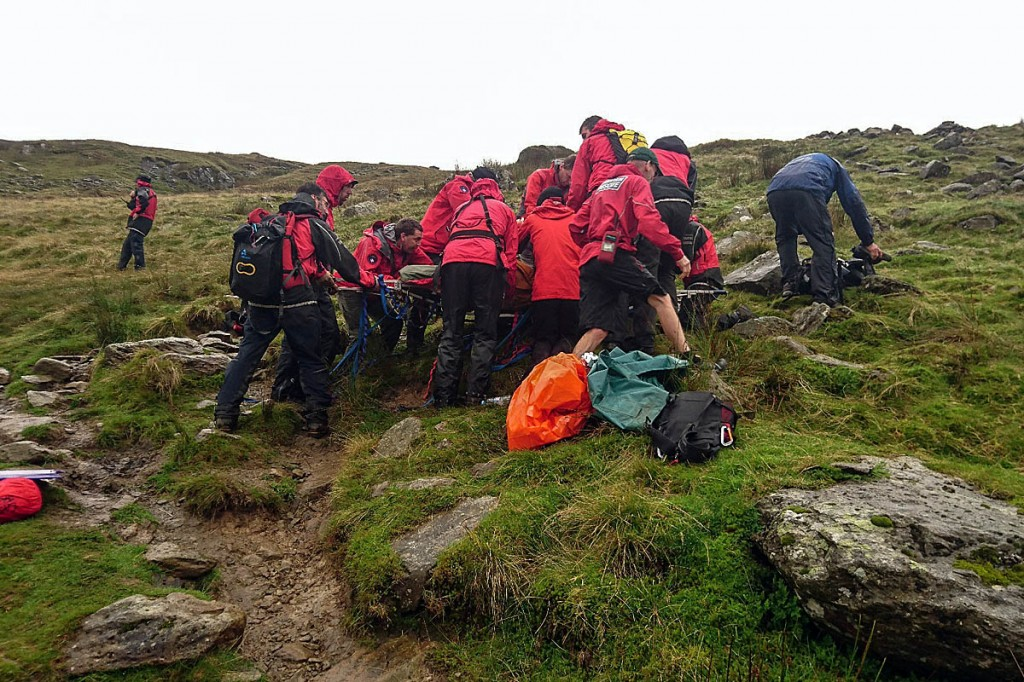 Rescuers treat the injured walker on Greenup Edge, between Borrowdale and Easedale. Photo: Keswick MRT