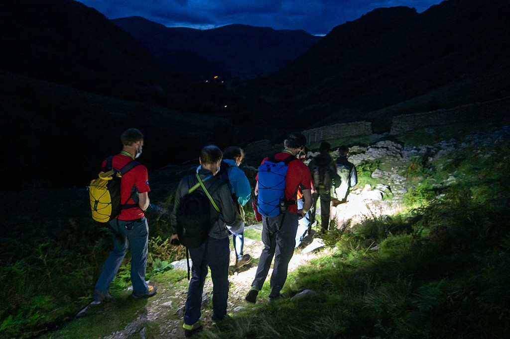 Rescuers accompany the lost walkers from the fells. Photo: Keswick MRT