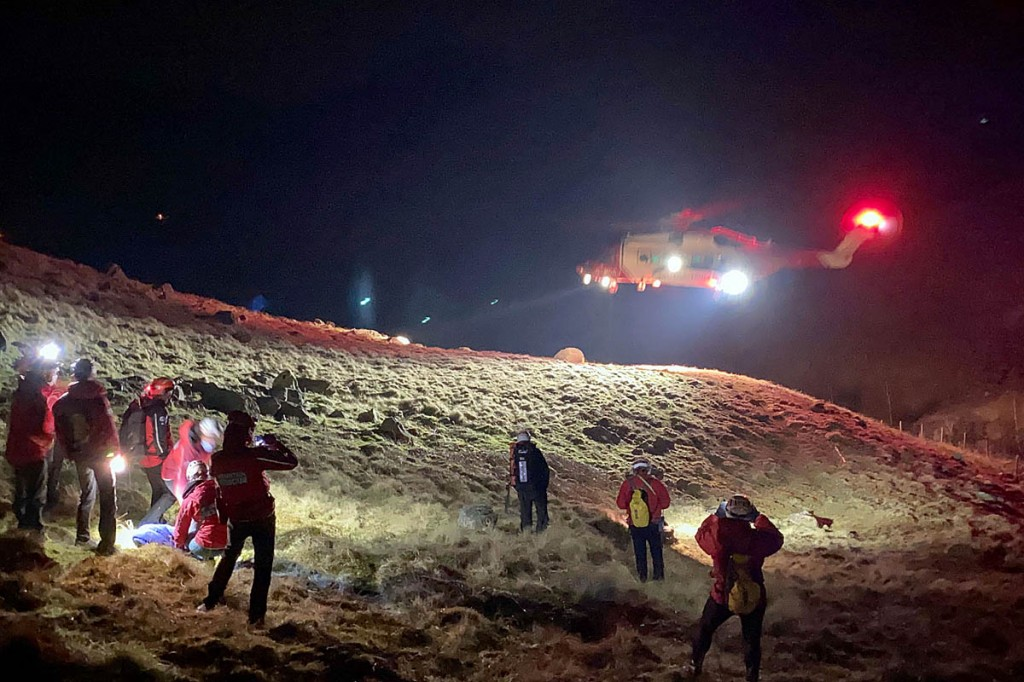 Rescuers and the Coastguard helicopter at the scene in Greenup Gill. Photo: Keswick MRT