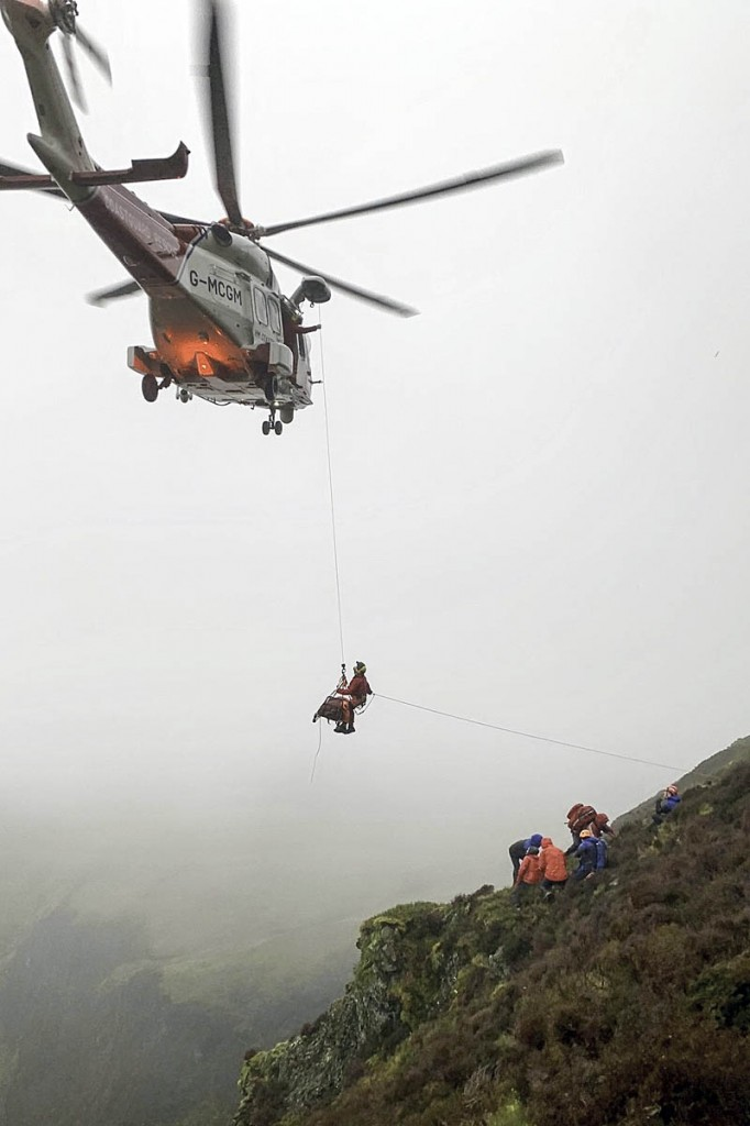 The injured walker is winched into the Coastguard helicopter. Photo: Keswick MRT