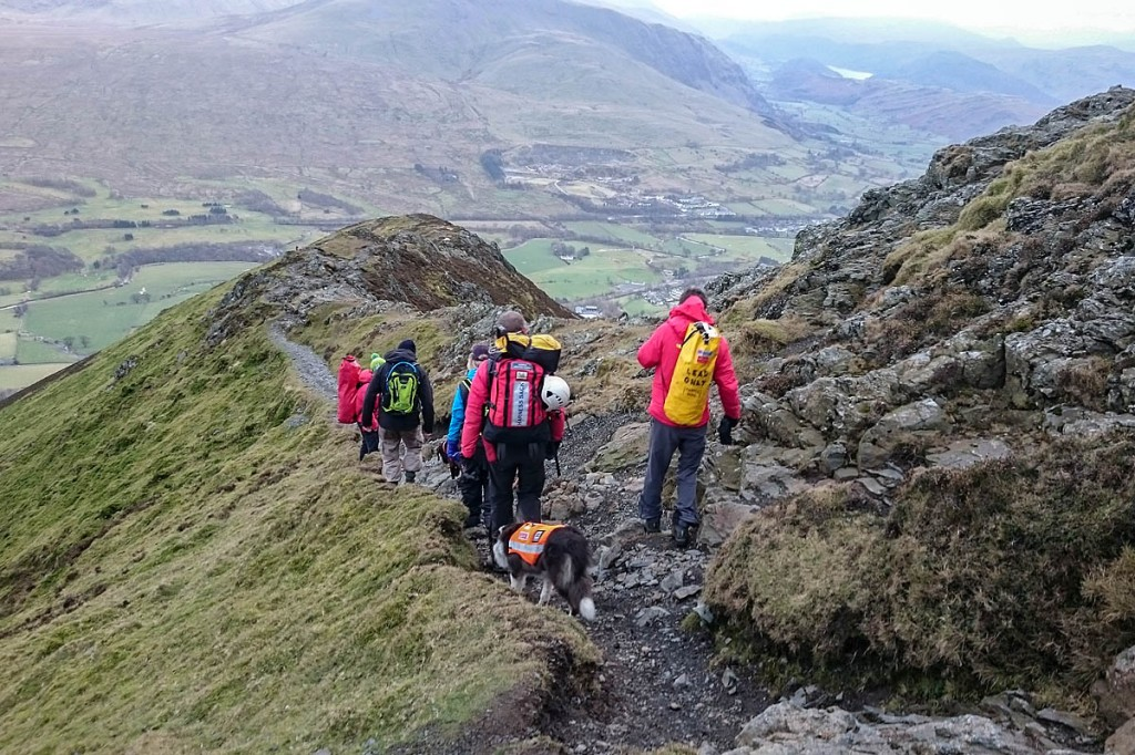Rescuers lead the walkers to safety down Hall's Fell Ridge. Photo: Keswick MRT