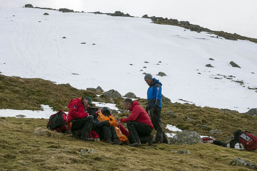 Rescuers with the injured walkers at the scene. Photo: Keswick MRT