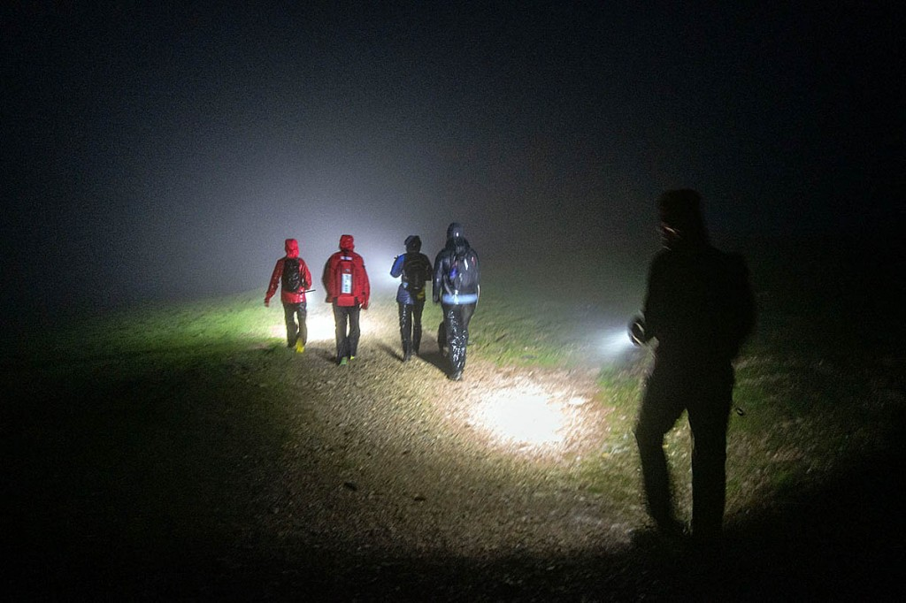 Rescuers accompany the walkers from the fell. Photo: Keswick MRT