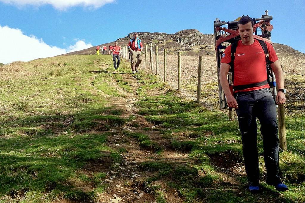 Team members make their way off the fell. Photo: Keswick MRT