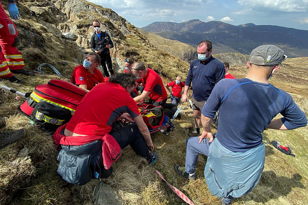 Rescuers tend to the injured walker. Photo: Keswick MRT