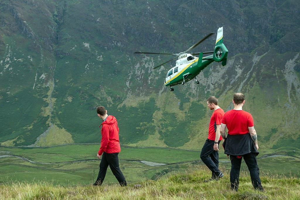 Rescuers and the air ambulance at the scene. Photo: Keswick MRT