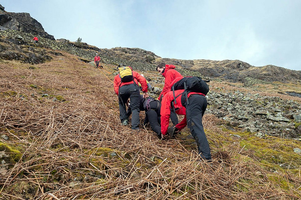 The walkers were helped to safety using ropes. Photo: Keswick MRT