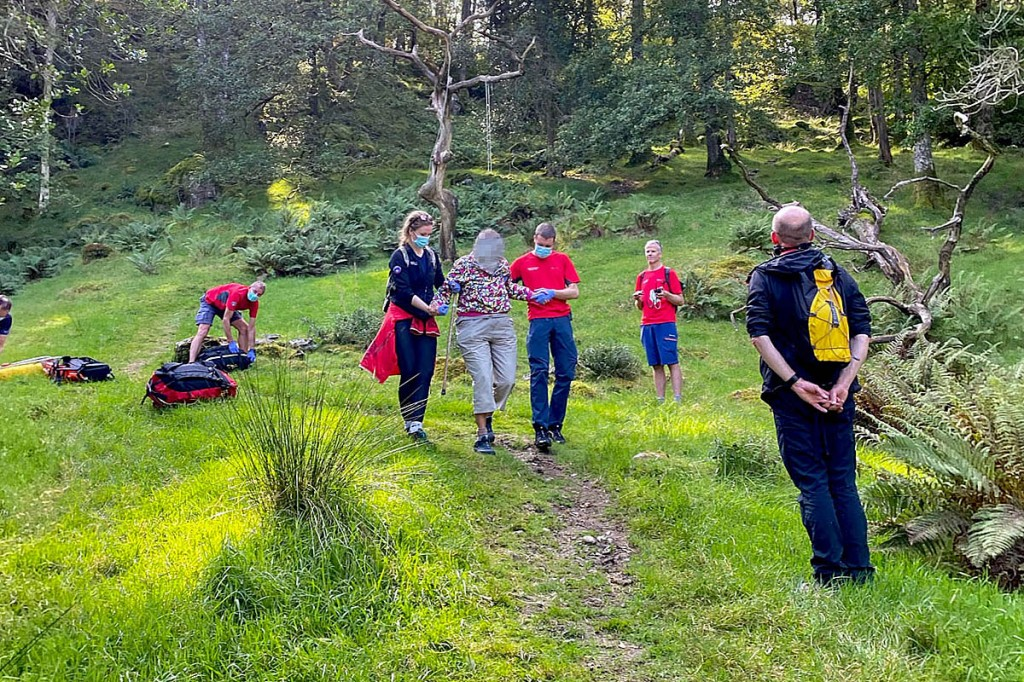 The walker is helped from the woods in Borrowdale. Photo: Keswick MRT