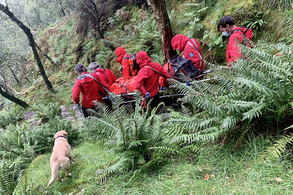 Team members stretcher the injured walker from King's How. Photo: Keswick MRT