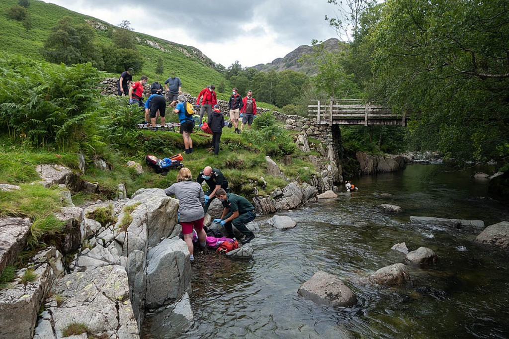 Rescuers deal with the injured teen in Langstrath. Photo: Keswick MRT