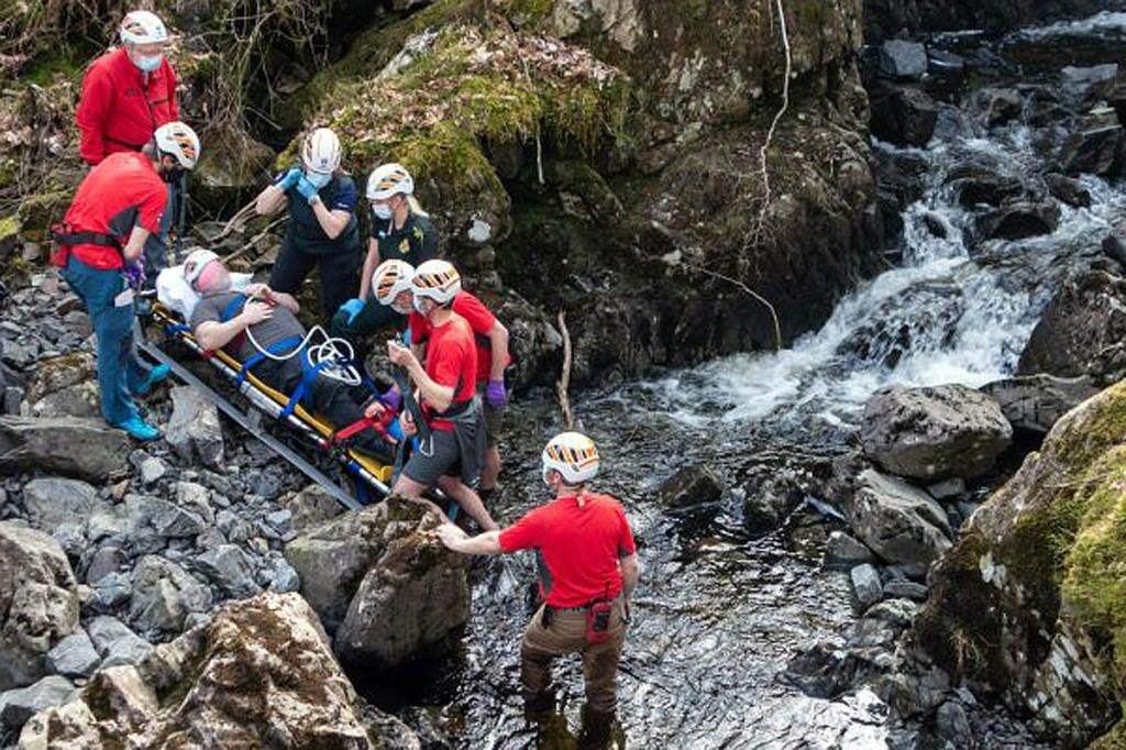 The injured man is stretchered from the gill. Photo: Keswick MRT