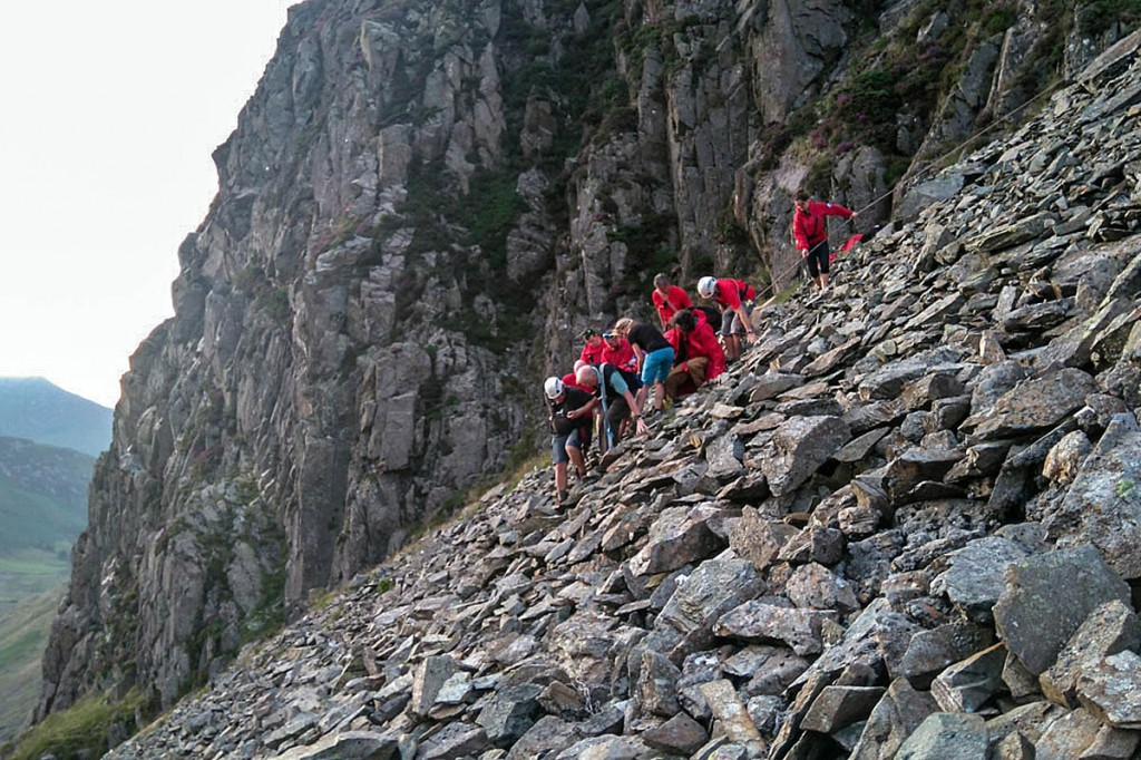 Team members at the boulder field with the fallen climber. Photo: Keswick MRT