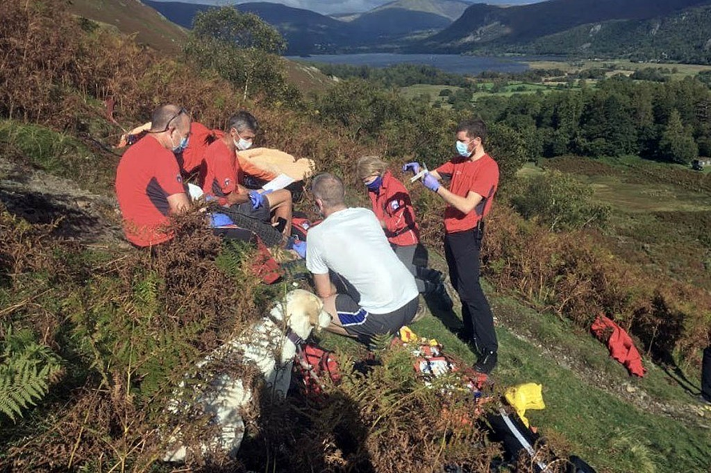 Rescuers tend to the injured walker above Borrowdale. Photo: Keswick MRT