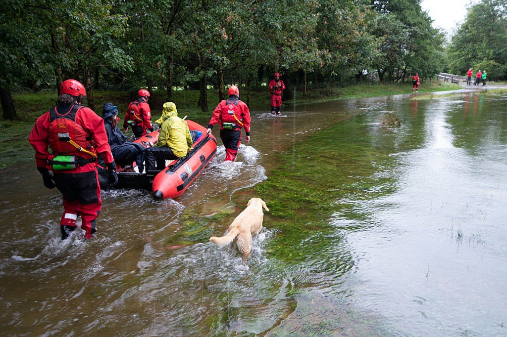 Rescuers used their boat to get the couple across the worst flooded areas. Photo: Keswick MRT