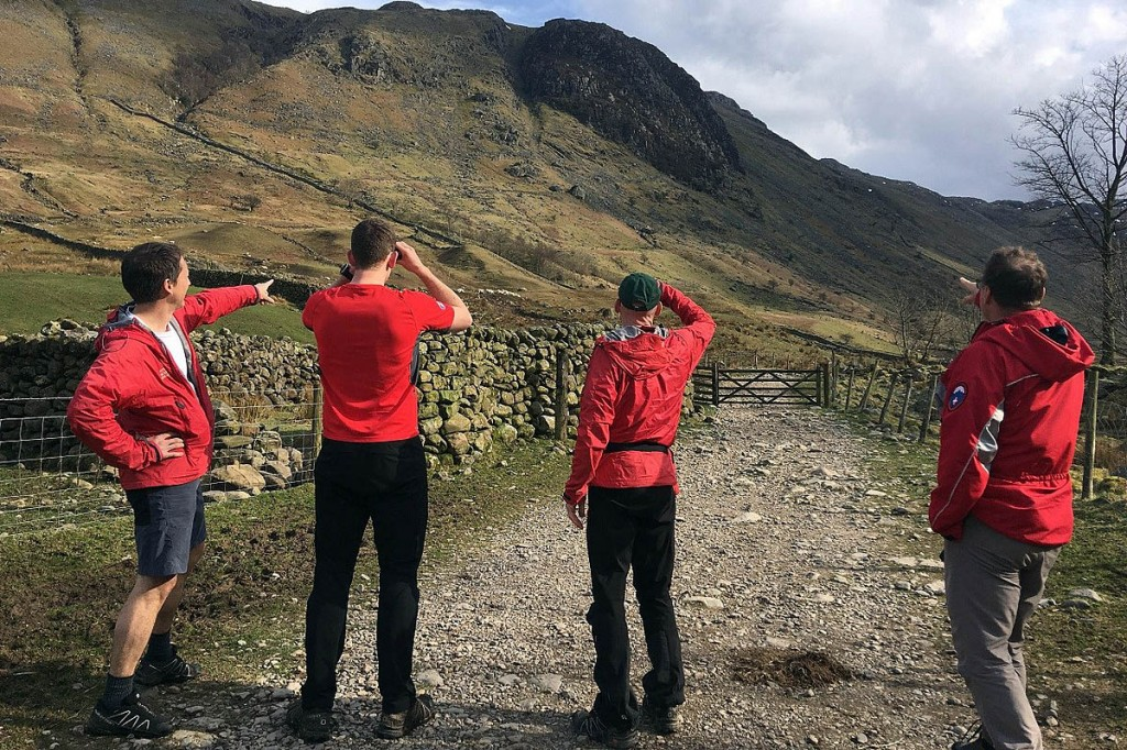Team members survey the scene near Seathwaite. Photo: Keswick MRT