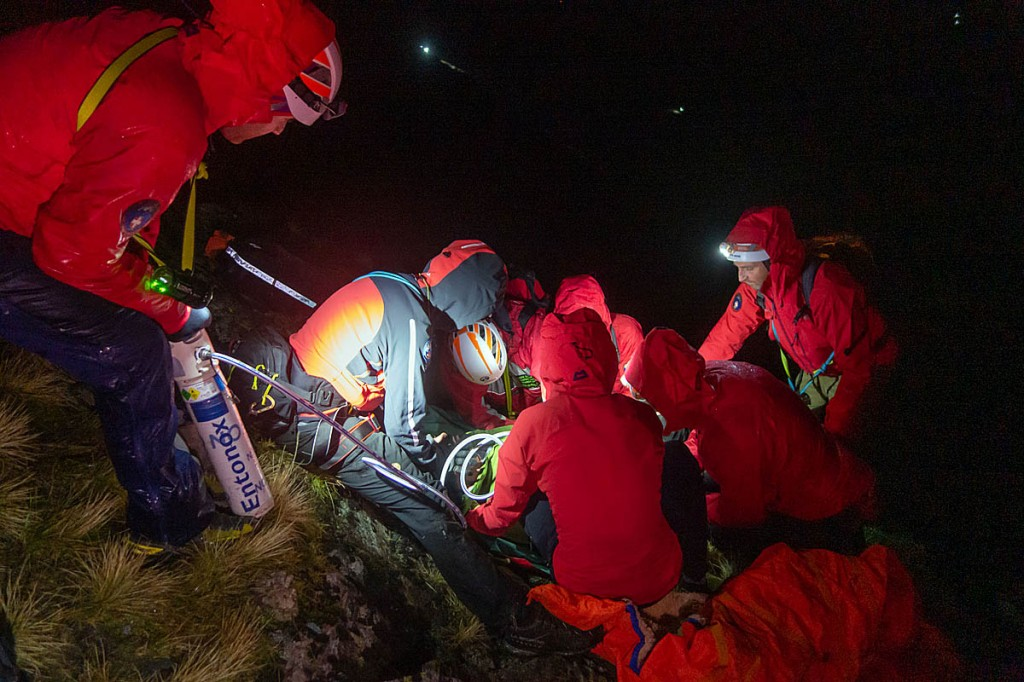 Rescuers treat the injured man on Blencathra. Photo: Keswick MRT