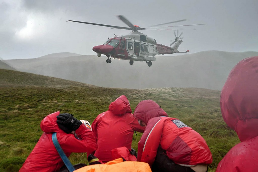 Rescuers with the Coastguard helicopter on the mountain. Photo: Keswick MRT