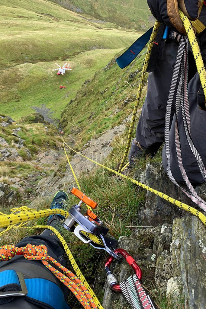 The team set up a rope system to lower one of the rescuers into the gully. Photo: Keswick MRT