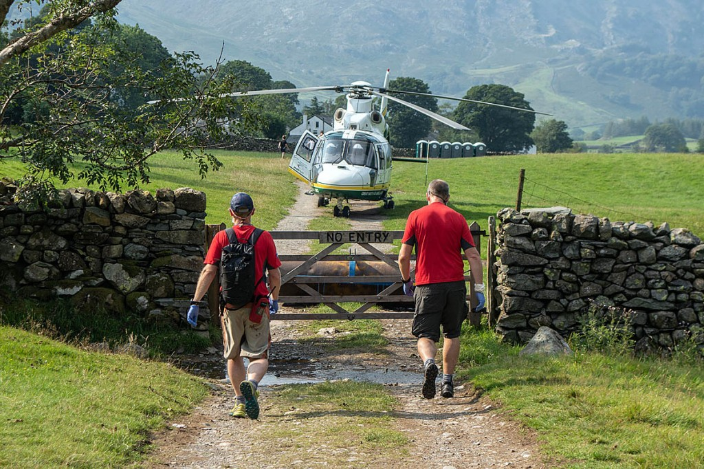 Rescuers and the air ambulance at the Stonethwaite incident. Photo: Keswick MRT