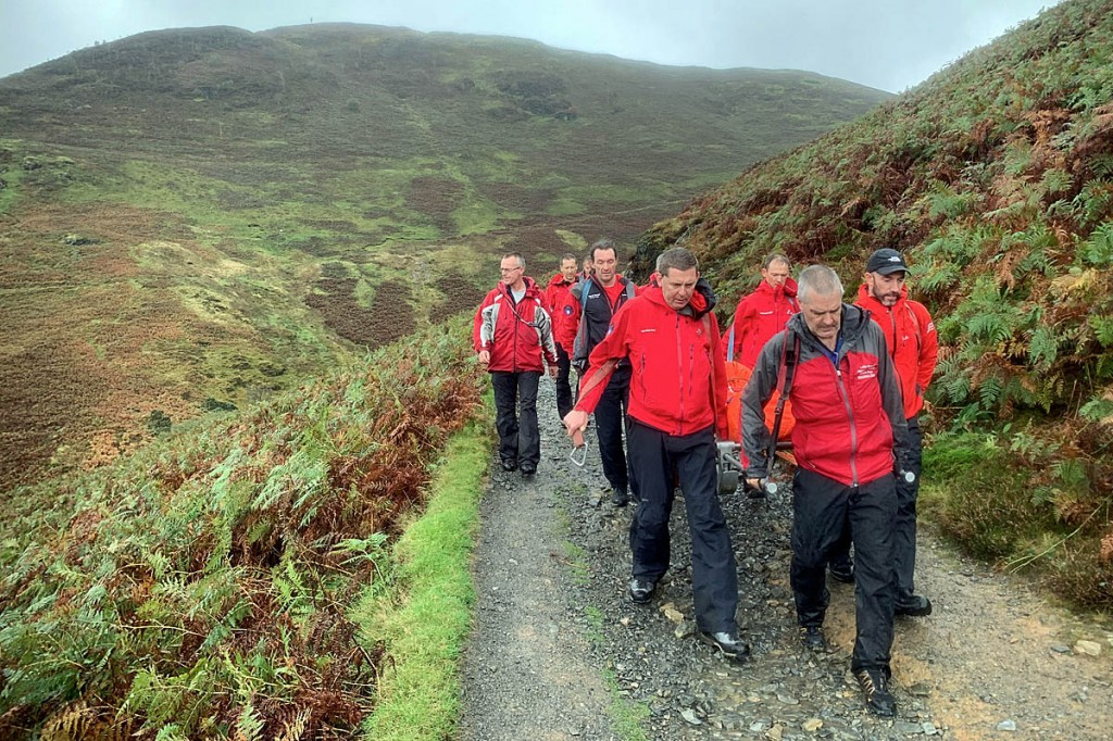Team members stretcher the man from Stonycroft Gill. Photo: Keswick MRT