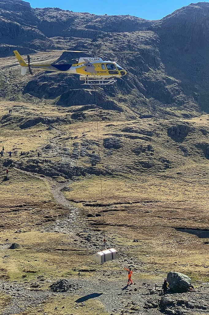 A helicopter lifts the stretcher box into position. Photo: Keswick MRT