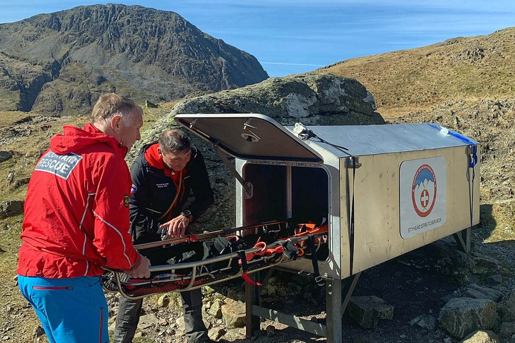 Team members place a stretcher in the new box. Photo: Keswick MRT