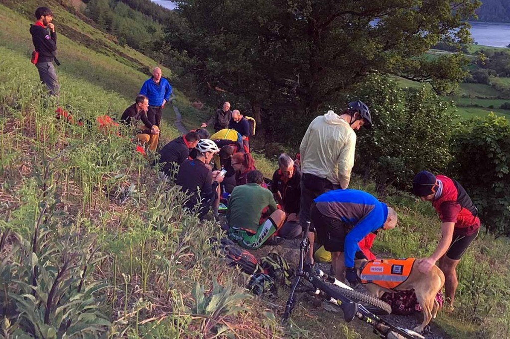 Rescuers tend to the injured mountain biker on the flanks of Ullock Pike. Photo: Keswick MRT