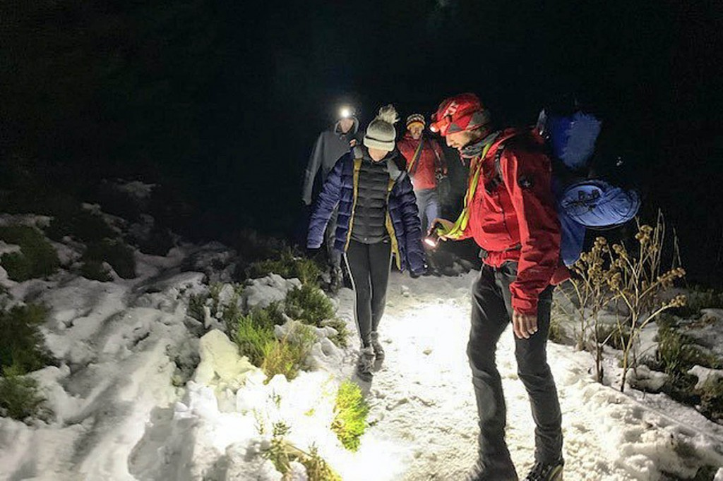 Rescuers aid the two forest walkers to safety. Photo: Keswick MRT