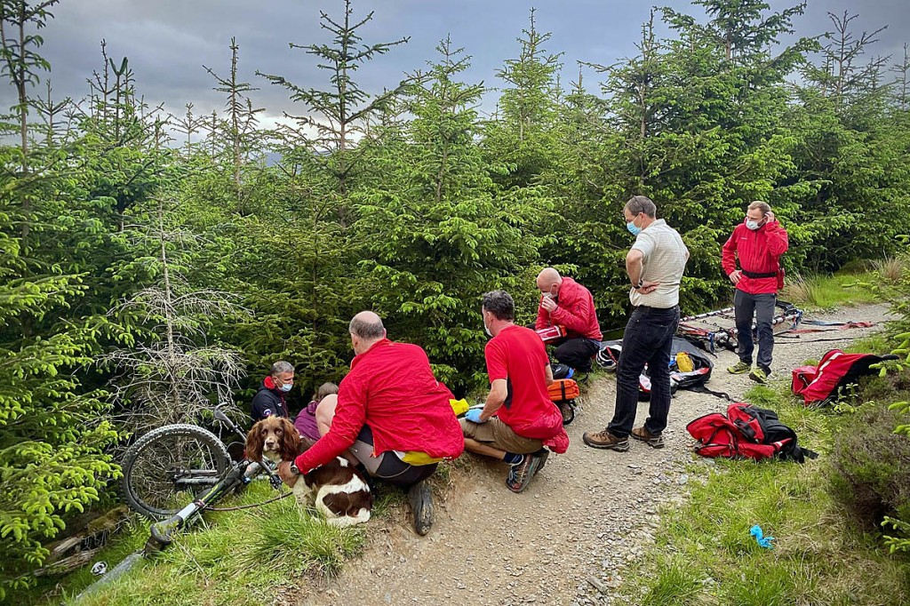 Rescuers tend to the injured cyclist in Whinlatter. Photo: Keswick MRT