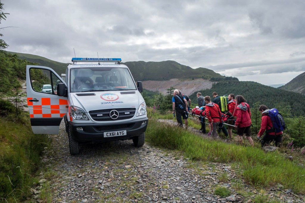 The injured rider is stretchered to the team vehicle in Whinlatter Forest. Photo: Keswick MRT