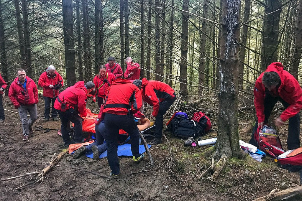 Team members at the rescue scene in Whinlatter Forest. Photo: Keswick MRT