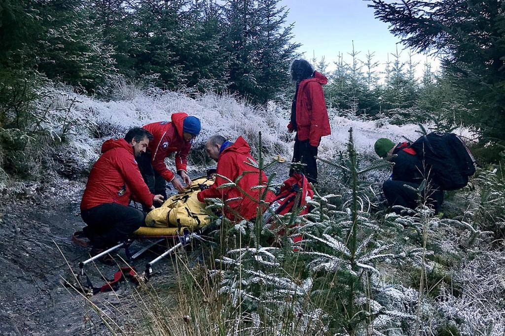 Rescuers tend to the injured mountain biker. Photo: Keswick MRT